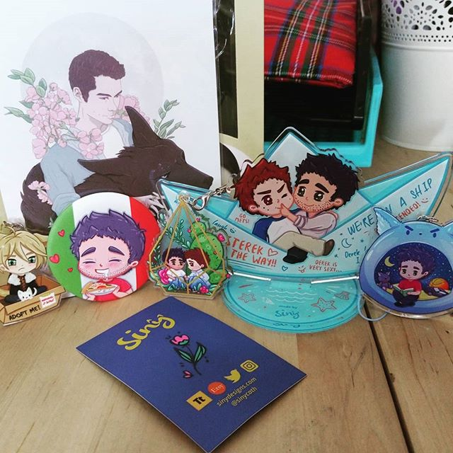 My latest order from @sinycath  much stereky goodness and one lil cranky russian boy.  Also the precious Tyler enjoying pizza badge.....LOVE IT!! #sterek #ternwolf #yuriplisetsky #yurionice #fangirlpurchases